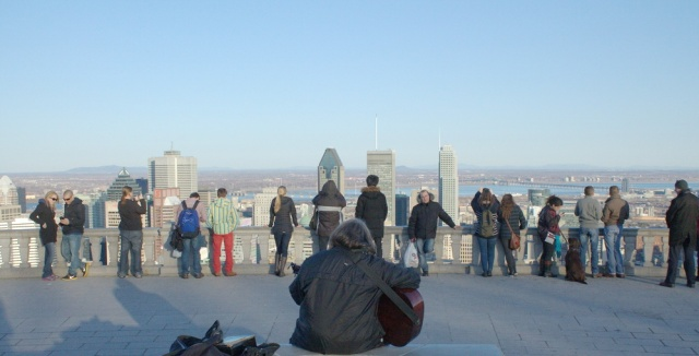 "A busker performs Led Zeppelin's ""Stairway to Heaven"" atop Mount Royal."